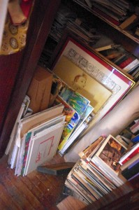 An assorted stack of art moldering in Sid's abandoned house (August, 2015).